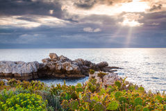 Dramatic spring sunset on the cape Milazzo, nature reserve Pisci Royalty Free Stock Images