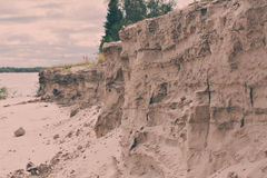 The dramatic steep sandy beach on the river. swallows` nests Royalty Free Stock Photo