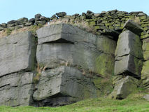 Dramatic stone outcrop in yorkshire moors with craggy sandstone Stock Photography
