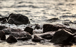 Dramatic stones in the water of gulf Royalty Free Stock Image