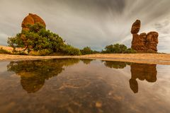 Dramatic Storm Clouds And Rain In Arches National Park Desert Stock Photo