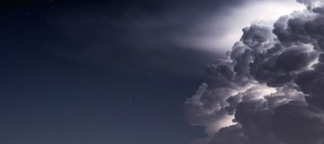 Free Dramatic Storm Clouds Background. Lightning In The Clouds. Royalty Free Stock Photos - 118857608