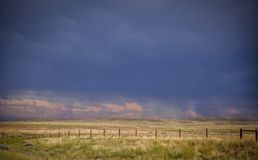 Free Dramatic Storm Clouds Over A Ranch Pasture Stock Photography - 125293292