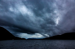 Dramatic storm clouds over Loch Ness. In winter time Stock Image