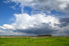 Dramatic storm clouds over meadow Royalty Free Stock Photos
