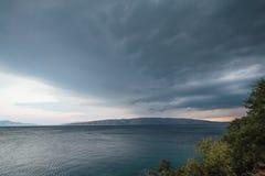 Dramatic storm clouds at the seashore royalty free stock photo