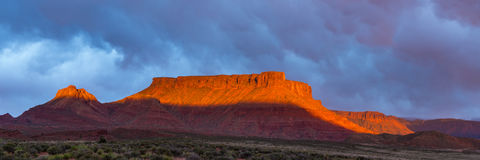 Dramatic storm at sunset in Canyon country of Southern Utah. Canyon country of Southern Utah during the storm at sunset Stock Photos