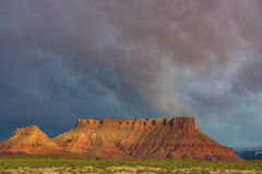 Dramatic storm at sunset in Canyon country of Southern Utah. Canyon country of Southern Utah during the storm at sunset Stock Images