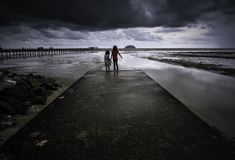 Dramatic stormy clouds at a beach stock image