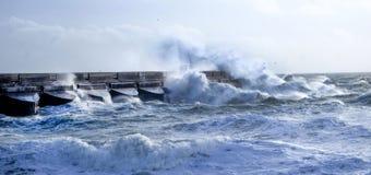Rough seas crashing against Brighton marina habour wall, UK royalty free stock images