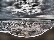 Dramatic stormy sky on beach Stock Images