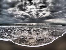 Dramatic stormy sky on beach. And waves; Maremma coast during winter season near Grosseto, Tuscany, Italy stock images