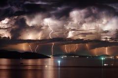 Dramatic stormy sky and lightning over Nha Trang Bay, Vietnam. Beautiful view of dramatic dark stormy sky and lightning over Nha Trang Bay of South China Sea in royalty free stock photos