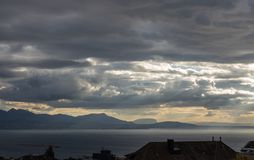 Stormy skies over the Leman lake. Dramatic stormy sky over the lake Leman. Beautiful view on lake Leman at evening and sunset. City of Lausanne, canton Vaud Royalty Free Stock Photography