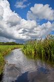 Dramatic stormy sky over river Stock Photo