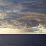 Dramatic stormy sky over sea Stock Photos