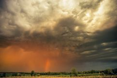 Dramatic stormy sky with rainbow over the countryside of Wisconsin, United States. stock photos