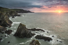 Dramatic stormy sunrise landscape over Bull Point in Devon Engla Royalty Free Stock Photos