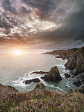 Dramatic stormy sunrise landscape over Bull Point in Devon Engla Stock Photos