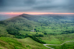 Stunning Sunrise over Mam Tor. Dramatic stormy sunrise from Mam Tor in the Peak District national park, looking out over the Hope Valley Royalty Free Stock Photo