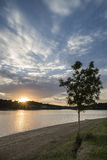 Dramatic stormy sunset over calm lake in Summer in English count Stock Image