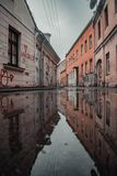 Dramatic street water reflection in Kaunas old town royalty free stock photo