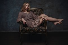 Dramatic studio portrait of a beautiful dreamy girl. Soft vintage toning. Stock Photo