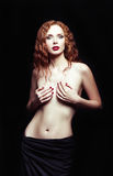 Dramatic studio portrait of sexy redhead girl Stock Image