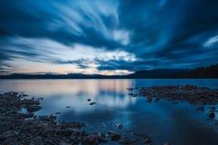 Dramatic summer light. A long exposure of a June sunset above Follsjå at Bolkesjø, Telemark, Norway Royalty Free Stock Image