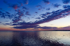Dramatic summer sunrise over Baltic sea. Scenic clouds Royalty Free Stock Photography
