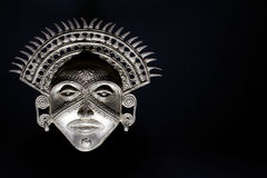 Dramatic Sun God Mask. This ancient mask is typical of the style found from many civilisations that honoured the power of the sun. The dramatic lighting adds to stock images