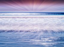 Dramatic sun rays over the tidal waves of ocean backdrop. Hd horizontal nobody blank empty space sparse vivid vibrant bright color rich white blue milk sea stock images