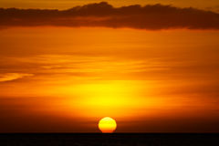 Dramatic Sun Setting into Ocean Stock Images