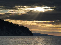 Dramatic sunrays at mountain bay Royalty Free Stock Images