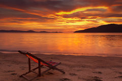 Dramatic sunrise. In Phuket, Thailand, with resting chair on foreground Stock Photo