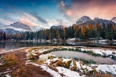 Dramatic sunrise on Antorno lake with Tre Cime di Lavaredo Drei Stock Photos