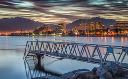 Dramatic sunrise at a beach of Eilat Stock Photo
