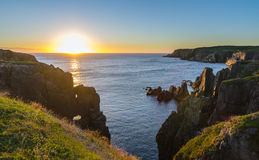 Dramatic sunrise cliffs at Cable John Cove Newfoundland.  Daybreak over Atlantic ocean Royalty Free Stock Images