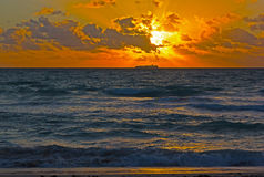Dramatic sunrise with clouds over the ocean. Royalty Free Stock Image