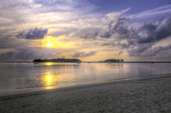 Dramatic Sunrise Colors. Dramatic sunrise light casts vibrant colors on the shoreline of Koh Samui in southern Thailand Royalty Free Stock Photo