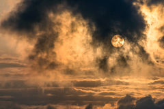 Dramatic sunrise. Dramatic golden sunrise above the clouds stock photo
