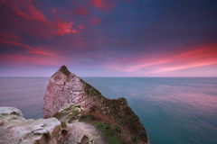 Dramatic sunrise over Atlantic ocean and cliffs. Etretat, France Royalty Free Stock Photos