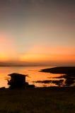 Dramatic Sunrise over bamboo raft Royalty Free Stock Image