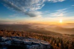Dramatic sunrise over beautiful mountain peaks. Decinsky Sneznik stock image