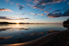 Dramatic sunrise over the calm river Royalty Free Stock Photos