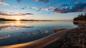Dramatic sunrise over the calm river Stock Images