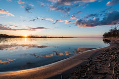 Dramatic sunrise over the calm river Royalty Free Stock Image