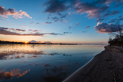 Dramatic sunrise over the calm river Stock Photos
