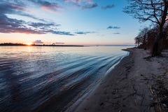 Dramatic sunrise over the calm river Stock Photo
