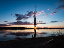 Dramatic sunrise over the calm river Stock Photography